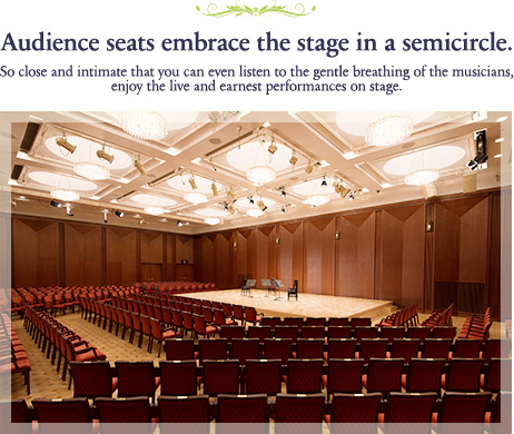 Audience seats embrace the stage in a semicircle.