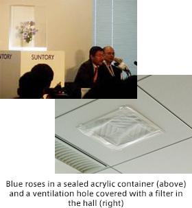 Blue roses in a sealed acrylic container (above) and a ventilation hole covered with a filter in the hall (right)